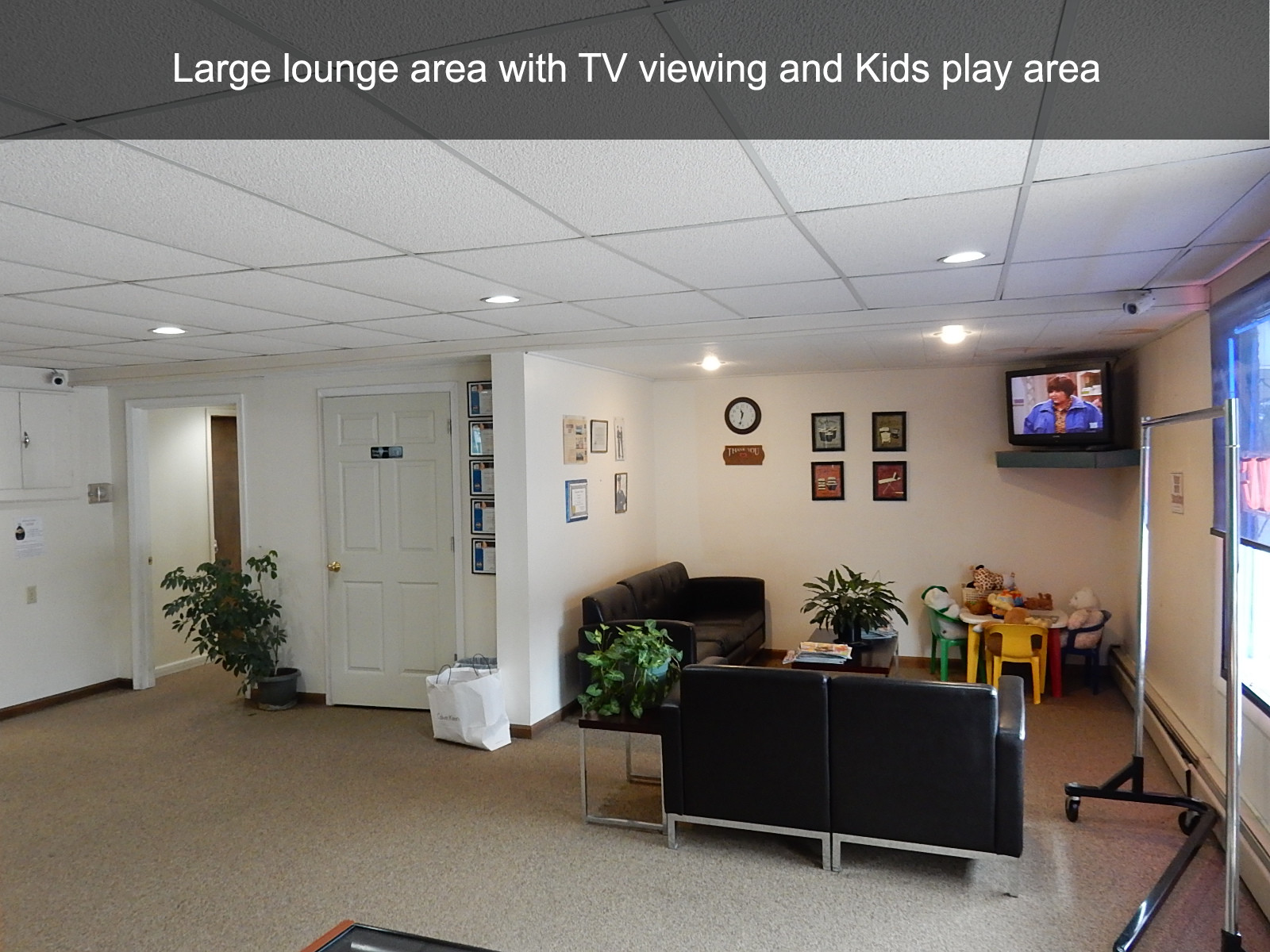 Large lounge area with TV viewing and Kids play area
