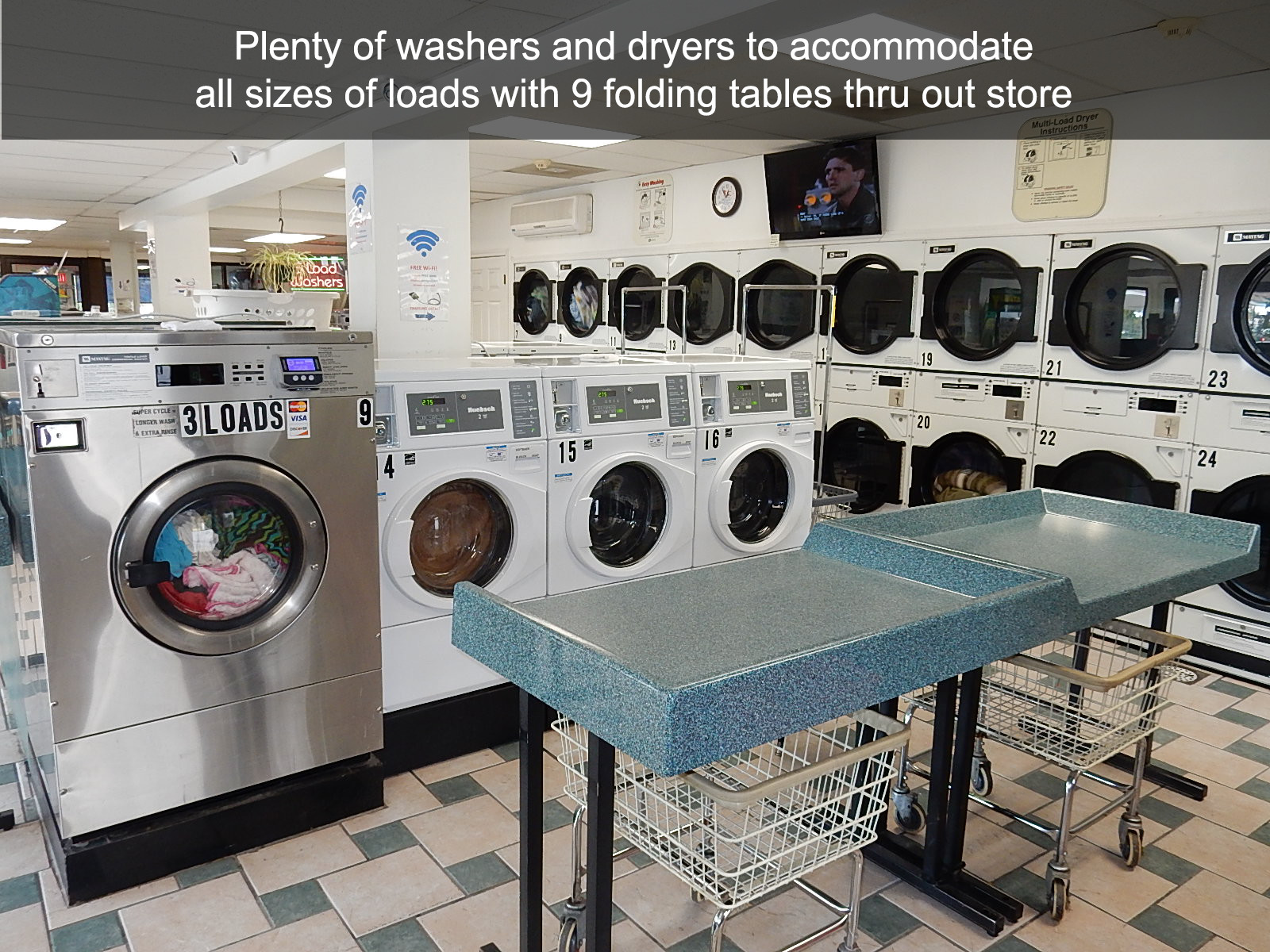 Plenty of washers and dryers to accommodate all sizes of loads with 9 folding tables thru out store