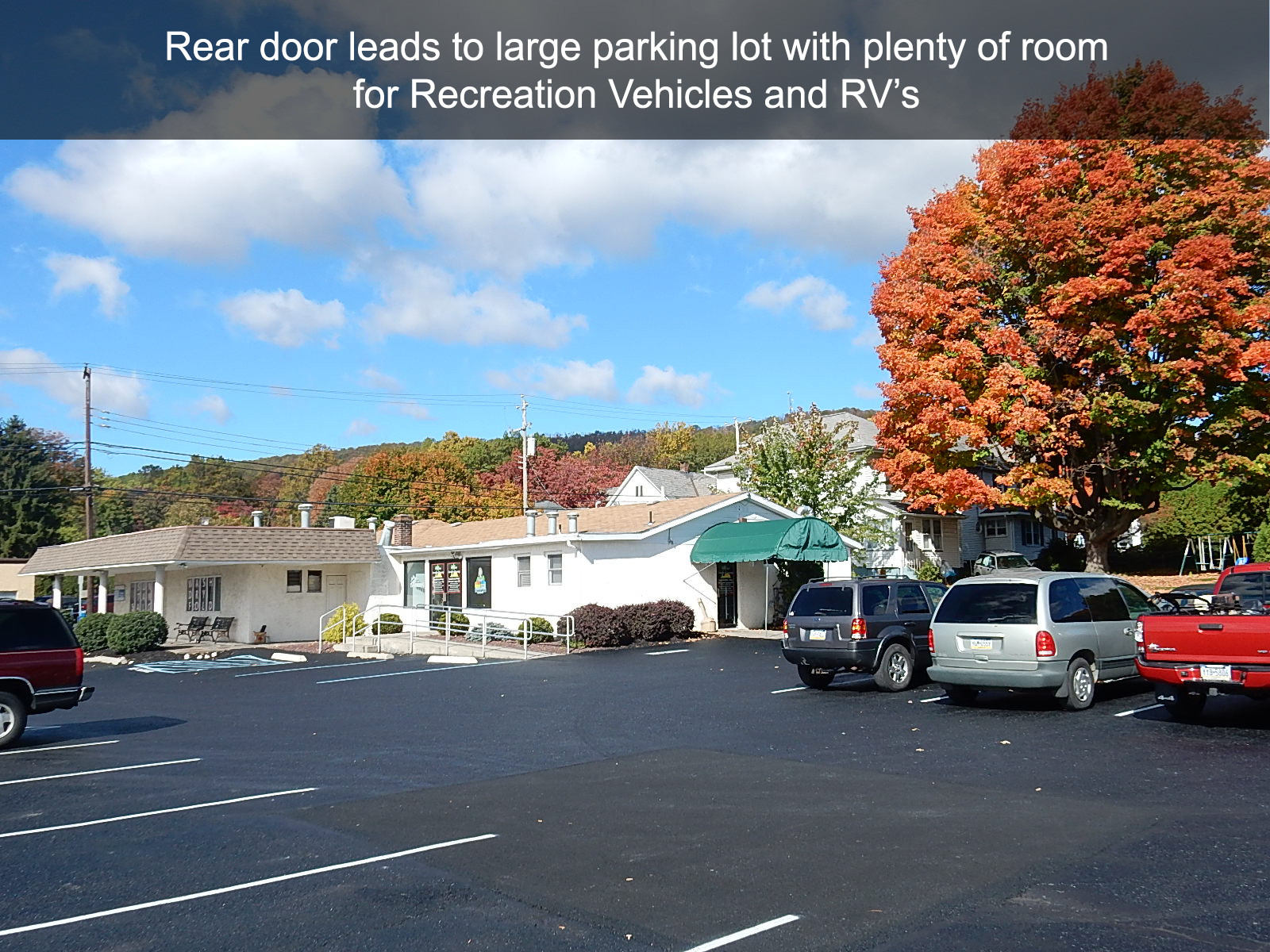 Rear door leads to large parking lot with plenty of room for Recreation Vehicles and RV's